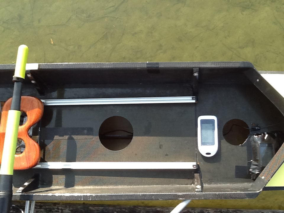 RowMotion mounted on boat (orthogonal) on. iPhone 4 in white box, iPhone 3 in black.